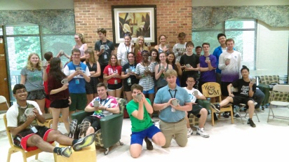 NIAHD students with the mugs they put handles on.