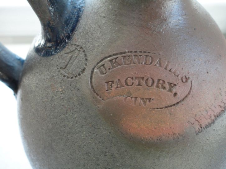 Closeup of stamp from Uzziah Kendall's Cincinnati stoneware factory.